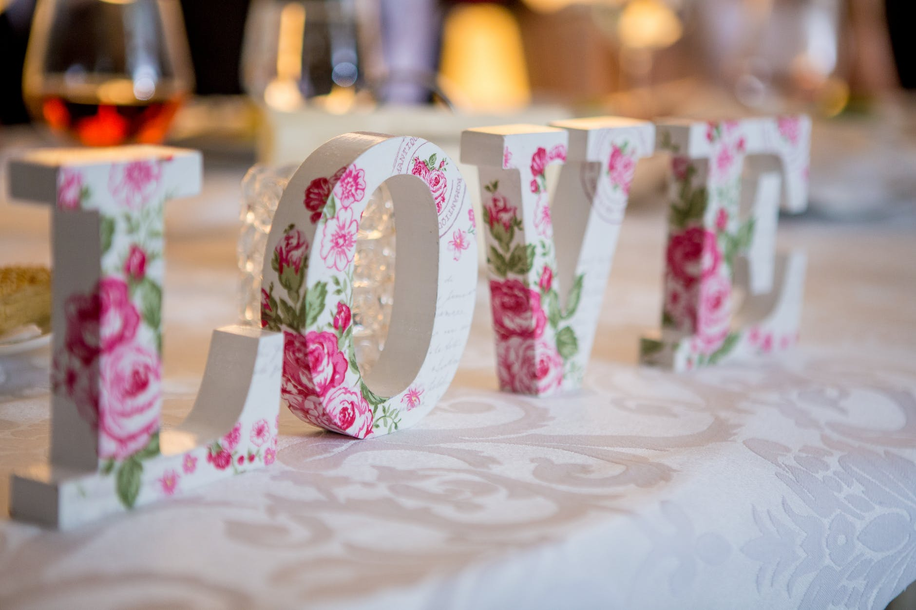 white and pink floral freestanding letter decor Photo by rovenimages.com