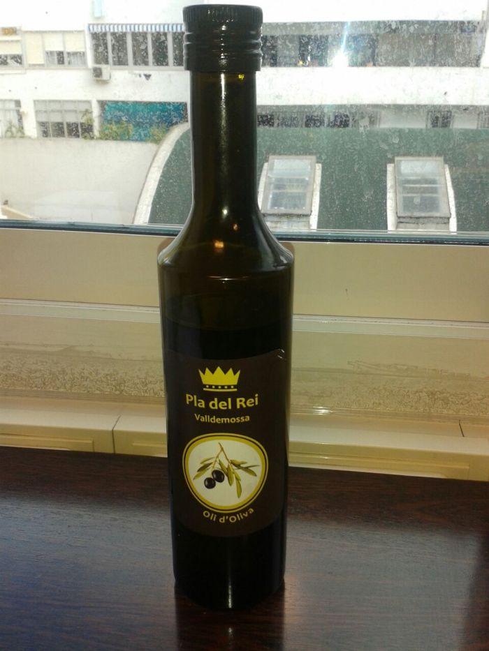 Etiqueta y botella aceite Pla del Rei